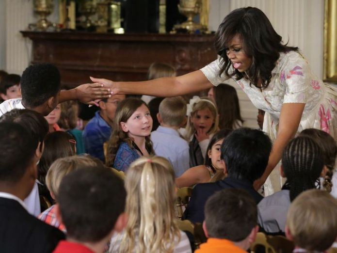 U.S. first lady Michelle Obama gives hugs and high-fives to children for Take Our Daughters and Sons to Work Day in the East Room of the White House April 20, 2016 in Washington, DC Obamas confirm 'films and series' Netflix deal Obamas confirm 'films and series' Netflix deal skynews children michelle obama 4251353
