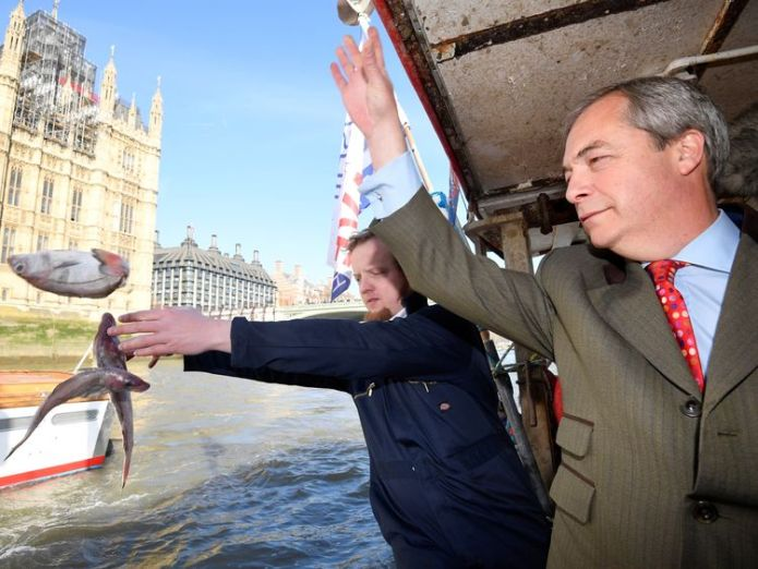 Nigel Farage throwing a dead fish into the Thames in a Brexit protest for Fishing for Leave  Theresa May faces rebellion threat over EU fishing 'demand' skynews fish river thames nigel farage 4260942