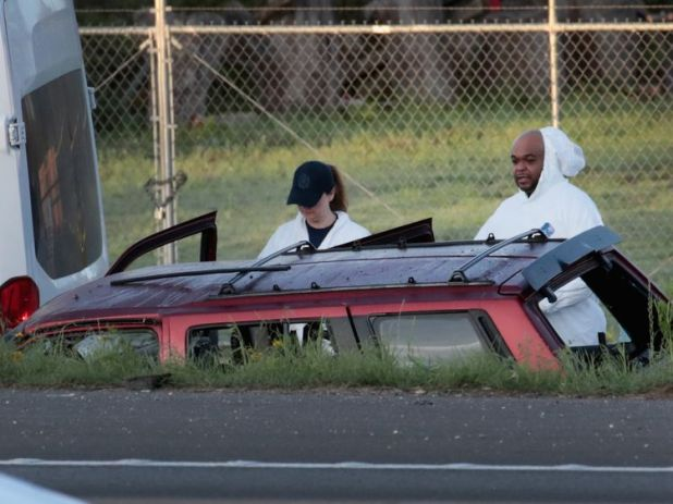 Police search the car where the suspected Texas bomber died