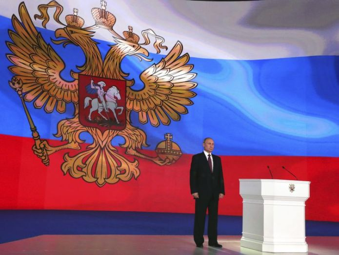 Russian President Vladimir Putin stands on the stage as he addresses the Federal Assembly US Condemns Russia's development of new super nuclear weapons US Condemns Russia's development of new super nuclear weapons skynews vladimir putin russia 4243765