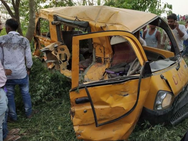 The mangled remains of a school bus after it was hit by a train in northern India, killing 13 children