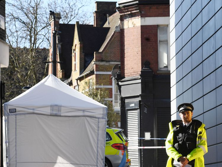 Police at the scene in Hackney, east London after a man in his 20s died after being stabbed