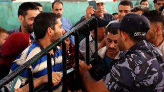 Palestinians crowd to get on a bus going to Egypt after the border was opened in a rare move israeli jets bomb militants after '25 mortars fired from gaza' Israeli jets bomb militants after '25 mortars fired from Gaza' skynews gaza palestinians 4315893