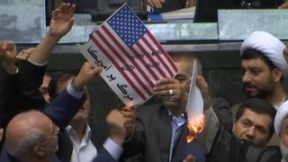 Iranian lawmakers have set fire to a paper US flag in the parliament in Tehran Iran hits back at Trump's decision to exit nuclear deal Iran hits back at Trump's decision to exit nuclear deal skynews iran us flag burning 4304518