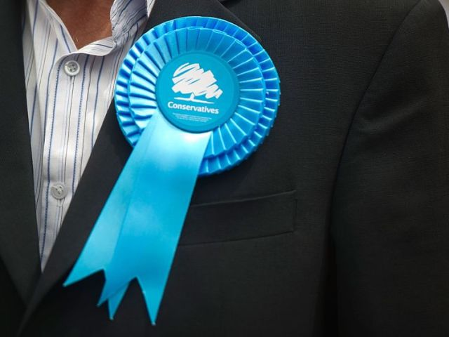 EALING, ENGLAND - MAY 21: A supporter's Conservative rosette on May 21, 2014 in Ealing, England. The rally comes in the final day of campaigning before polls open for the European Parliament election tomorrow. (Photo by Bethany Clarke/)