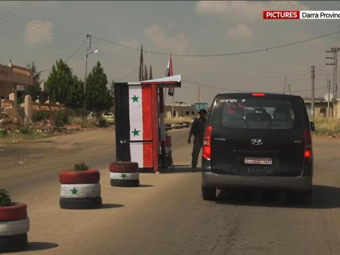 Checkpoints line the road to the city syrian government extends control across the devastated south Syrian government extends control across the devastated South skynews daraa syria 4325246