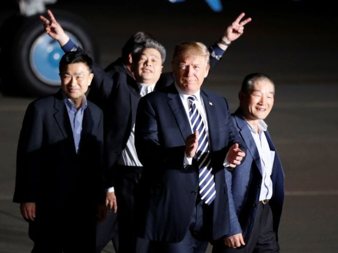 The three Americans formerly held hostage in North Korea gesture next to U.S.President Donald Trump, upon their arrival at Joint Base Andrews Donald Trump hails Kim Jong Un as North Korea prisoners arrive home Donald Trump hails Kim Jong Un as North Korea prisoners arrive home skynews donald trump prisoners hostages 4305463