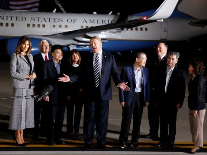 Donald Trump talks to the media next to the three Americans formerly held hostage in North Korea Donald Trump hails Kim Jong Un as North Korea prisoners arrive home Donald Trump hails Kim Jong Un as North Korea prisoners arrive home skynews donald trump prisoners hostages 4305468