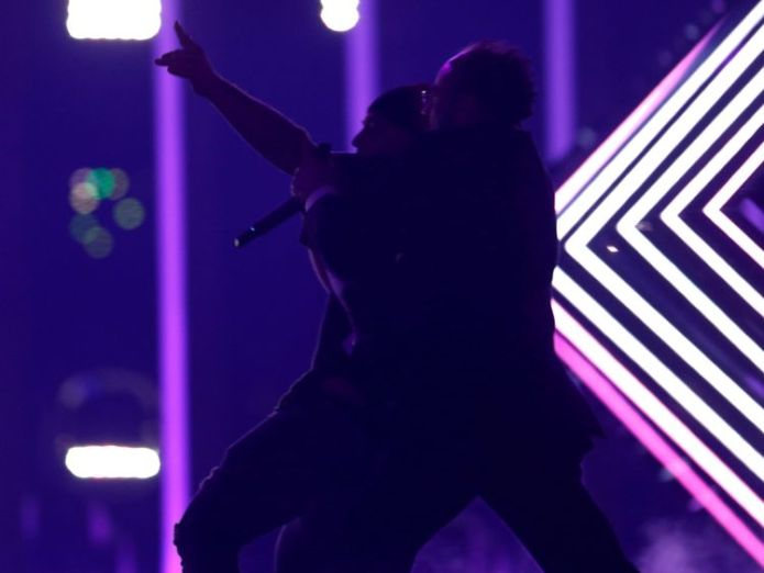 "Security subdues a person who invaded the stage as United Kingdom's SuRie performed ""Storm"" during the Grand Final of Eurovision Song Contest 2018 at the Altice Arena hall in Lisbon, Portugal, May 12, 2018. REUTERS/Pedro Nunes Stage invader grabs mic during UK Eurovision performance Stage invader grabs mic during UK Eurovision performance skynews eurovision song contest 4308326"