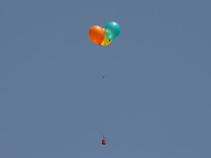 Flaming balloons are released by Palestinian demonstrators to the Israeli side  Palestinians shot dead as 'volatile' Gaza border protest intensifies Palestinians shot dead as 'volatile' Gaza border protest intensifies skynews gaza palestinian protests 4306744