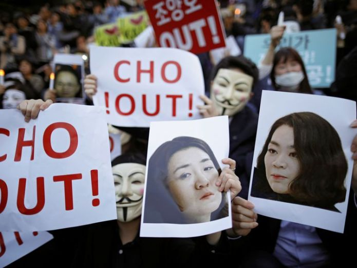 People hold portraits depicting Cho Hyun-ah and Cho Hyun-min, daughters of Korean Air Lines' chairman Cho Yang-ho as they take part in a protest against the abuse of power by them, in central Seoul, South Korea, May 4, 2018. REUTERS/Kim Hong-Ji NO RESALES. NO ARCHIVES Korean Air family in trouble again after 'nut rage' Korean Air family in trouble again after 'nut rage' skynews korean airlines korea 4322566