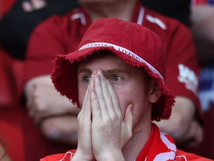 A Liverpool fan watches on as his side lose to Real Madrid Bale sinks Liverpool dreams in Champions League final Bale sinks Liverpool dreams in Champions League final skynews liverpool real madrid 4321511