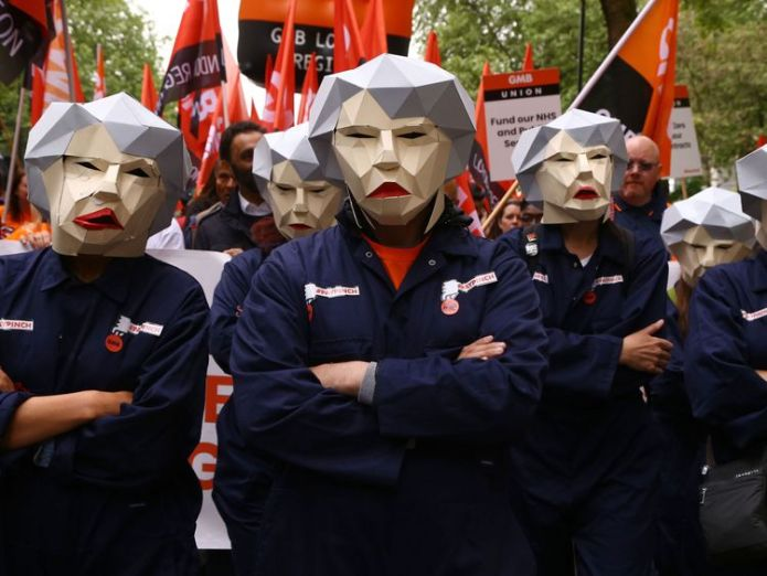 Some protesters dressed up as Theresa May Corbyn attends London rally amid 'worst pay squeeze for workers for 200 years' Corbyn attends London rally amid 'worst pay squeeze for workers for 200 years' skynews london rally tuc 4307808