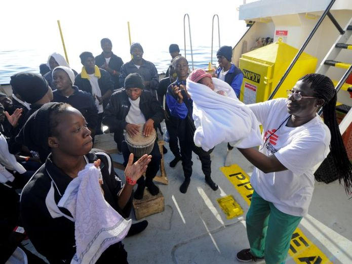 Migrants dance and sing to celebrate the birth of Miracle Baby boy named 'Miracle' born on migrant rescue ship Baby boy named 'Miracle' born on migrant rescue ship skynews miracle aquarius 4321896
