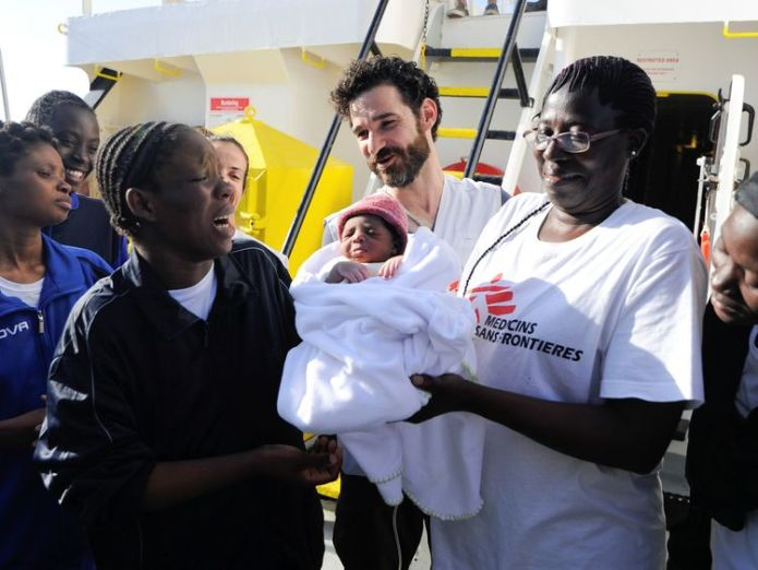 The new mother (L) with her baby and MSF staff Baby boy named 'Miracle' born on migrant rescue ship Baby boy named 'Miracle' born on migrant rescue ship skynews miracle msf aquarius 4321894