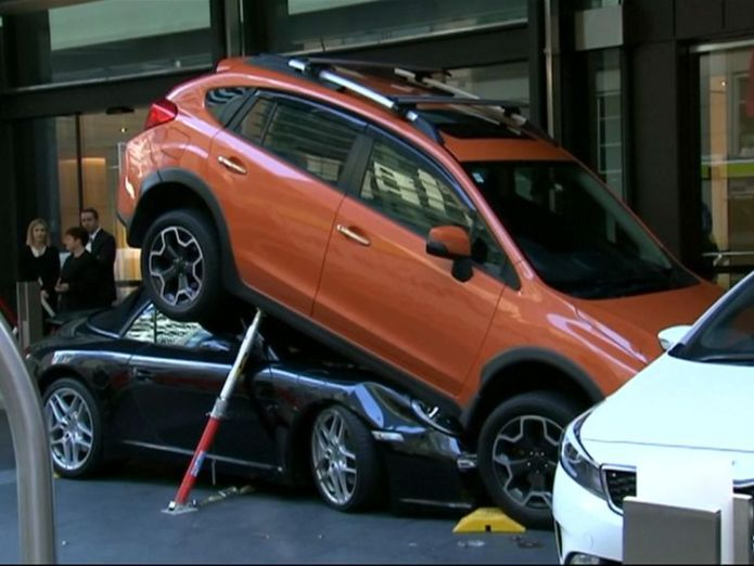 A hotel valet had a lucky escape after a sports car he was parking ended up underneath another vehicle hotel valet cut out of porsche after botched parking job in sydney Hotel valet cut out of Porsche after botched parking job in Sydney skynews porsche car sydney hotel 4324564