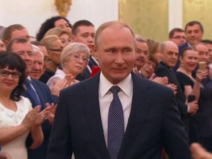 Putin smiles at attendees in the Great Kremlin Palace vladimir putin has been sworn in as russian president Vladimir Putin has been sworn in as Russian president skynews putin vladimir smiling 4303211