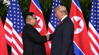 North Korea's leader Kim Jong Un (L) shakes hands with US President Donald Trump (R) at the start of their historic US-North Korea summit, at the Capella Hotel on Sentosa island in Singapore on June 12, 2018. - Donald Trump and Kim Jong Un have become on June 12 the first sitting US and North Korean leaders to meet, shake hands and negotiate to end a decades-old nuclear stand-off  Second North Korea summit 'quite soon' skynews handshake korea trump 4333765