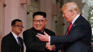 Donald Trump and Kim Jong Un struck an optimistic tone at the start of the summit Confusion as North Korea says US will lift sanctions Confusion as North Korea says US will lift sanctions skynews trump kim jong un 4333786