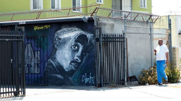 A wall dedicated to the memory of US rapper Tupac Shakur is seen on May 26, 2016 in Los Angeles, California. Twenty years after his death, Tupac still reigns. Other rappers have succeeded him in stardom, and promotional efforts around Tupac have been haphazard, but the artist who died at age 25 on September 13, 1996, in Las Vegas, maintains a hold that is among the most enduring in recent times. / AFP / VALERIE MACON / TO GO WITH AFP STORY by Shaun TANDON, '20 years on, Tupac reigns as potent gl Shootings in the history of rap Shootings in the history of rap skynews tupac wall shootings 4340503
