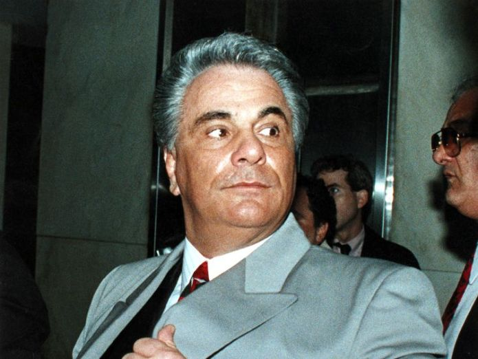 Former Mafia boss John Gotti, who died in 2002, pictured here in 1990 John Travolta's new film Gotti given rare 0% score on Rotten Tomatoes John Travolta's new film Gotti given rare 0% score on Rotten Tomatoes john gotti mafia mob boss sky news 4339324