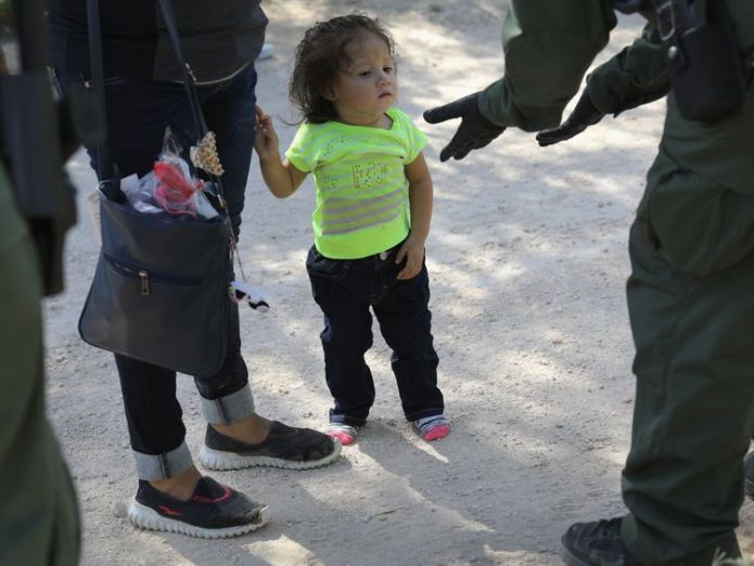 Border Patrol agents take Central American asylum seekers into custody on June 12, 2018 near McAllen, Texas Recording captures children's cries for parents at US border Recording captures children's cries for parents at US border skynews asylum seekers texas border patrol 4339817