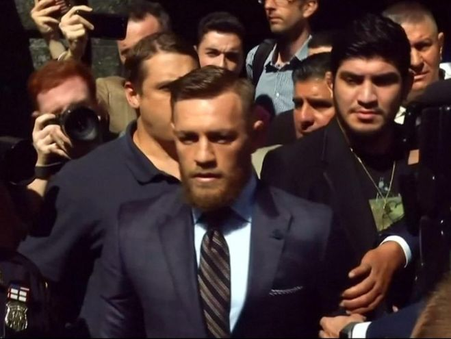Conor McGregor leaves court after the brief hearing