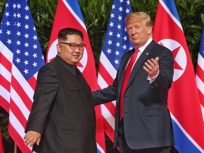 SINGAPORE - JUNE 12: In this handout photo, North Korean leader Kim Jong-un (L) meets U.S. President Donald Trump during their historic U.S.-DPRK summit at the Capella Hotel on Sentosa island on June 12, 2018 in Singapore. U.S. President Trump and North Korean leader Kim Jong-un held the historic meeting between leaders of both countries on Tuesday morning in Singapore, carrying hopes to end decades of hostility and the threat of North Korea's nuclear program. (Photo by Kevin Lim/THE STRAITS TIM Donald Trump nominated for Nobel Peace Prize by Norwegian politicians Donald Trump nominated for Nobel Peace Prize by Norwegian politicians skynews donald trump kim jong un 4334269