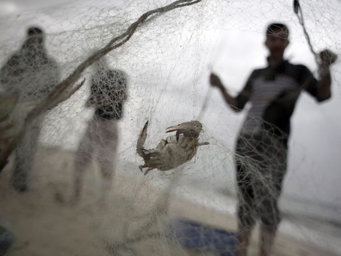 Palestinian fishermen check their nets on the shore of the Mediterranean Sea Tourists visiting Mediterranean Sea leaving 'toxic legacy of plastic waste' Tourists visiting Mediterranean Sea leaving 'toxic legacy of plastic waste' skynews fishing nets ocean 4330578