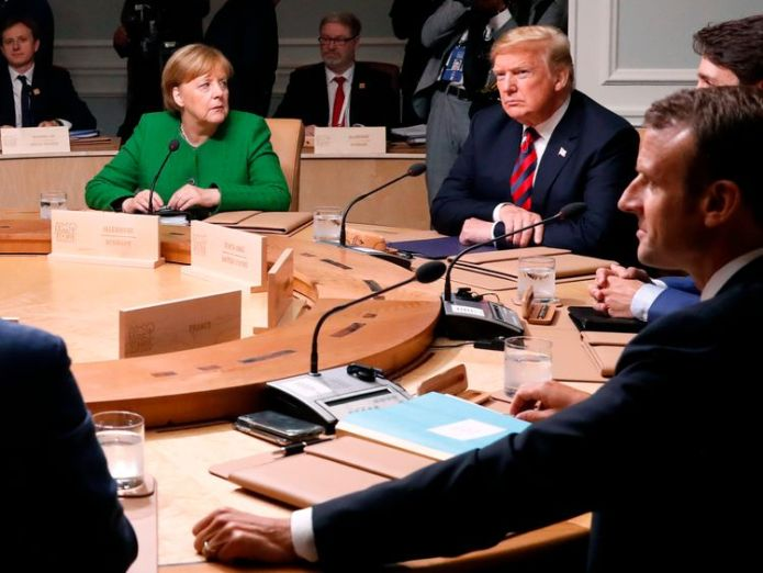 Germany's Chancellor Angela Merkel looks over at U.S. President Donald Trump as they meet with Canada's Prime Minister Justin Trudeau, France's President Emmanuel Macron and the other leaders for a plenary session at the G7 summit in Charlevoix, Quebec, Canada, June 8, 2018. REUTERS/Leah Millis European members of G7 reject Donald Trump's call to reinstate Russia European members of G7 reject Donald Trump's call to reinstate Russia skynews g7 trump merkel world 4331387