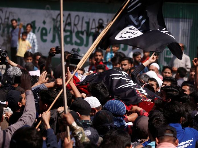 People carry the body of Kaisar Ahmad Bhat during the funeral Shotguns fired by police at funeral of Kashmir protester Shotguns fired by police at funeral of Kashmir protester skynews kashmir funeral protests 4326432