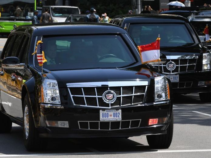 The motorcade transporting US President Donald Trump drives towards the Istana, the official residence of the Singaporean prime minister, for a bilateral programme ahead of the US-North Korea summit in Singapore on June 11, 2018 Trump meets Singapore PM ahead of N Korea talks Trump meets Singapore PM ahead of N Korea talks skynews loong trump singapore 4333063