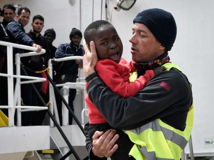 A helper from Doctors Without Borders (MSF) holds a Nigerian child as he and his mother (unseen) disembark from the MV Aquarius upon its arrival at the Sicilian port of Messina last month Tensions flare as Macron criticises Italy for turning away migrant ship Tensions flare as Macron criticises Italy for turning away migrant ship skynews migrant aquarius italy 4333951