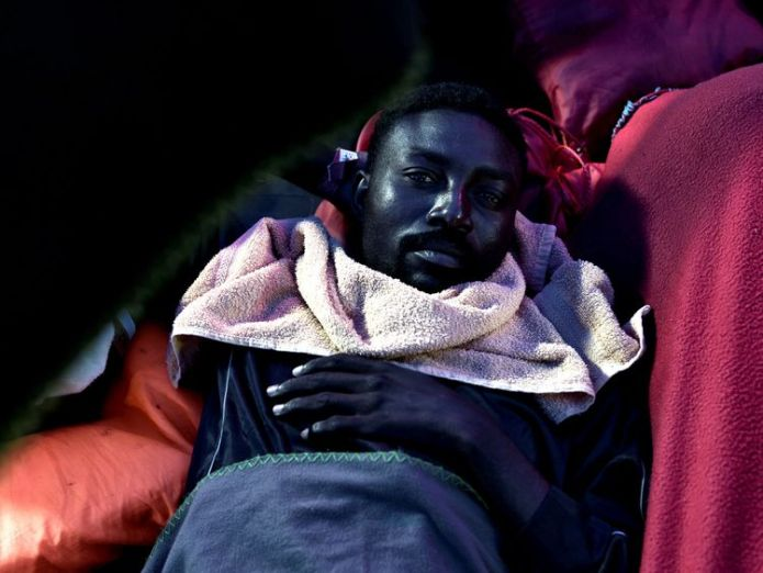 A migrant pictured on board the Aquarius vessel on its way to Valencia Hundreds of migrants on Aquarius rescue ship set to arrive in Spain Hundreds of migrants on Aquarius rescue ship set to arrive in Spain skynews migrant boat aquarius 4335869