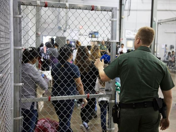 A Border Patrol agent watches detainees Trump set to end migrant family separations Trump set to end migrant family separations skynews migrant us border cages 4339091