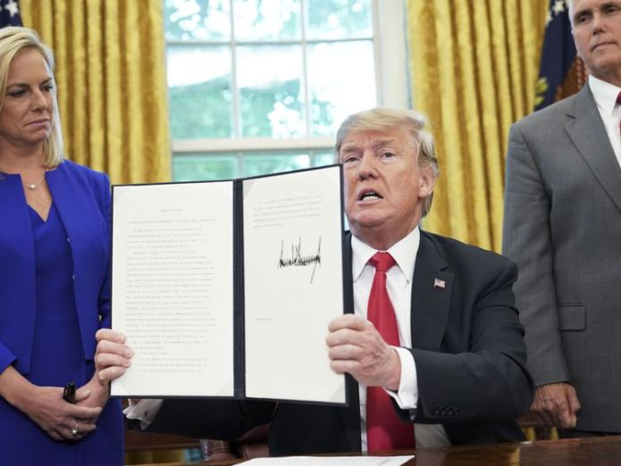 Trump signs executive order 17 states sue Donald Trump to reunite immigrant families 17 states sue Donald Trump to reunite immigrant families skynews president trump executive order 4341347