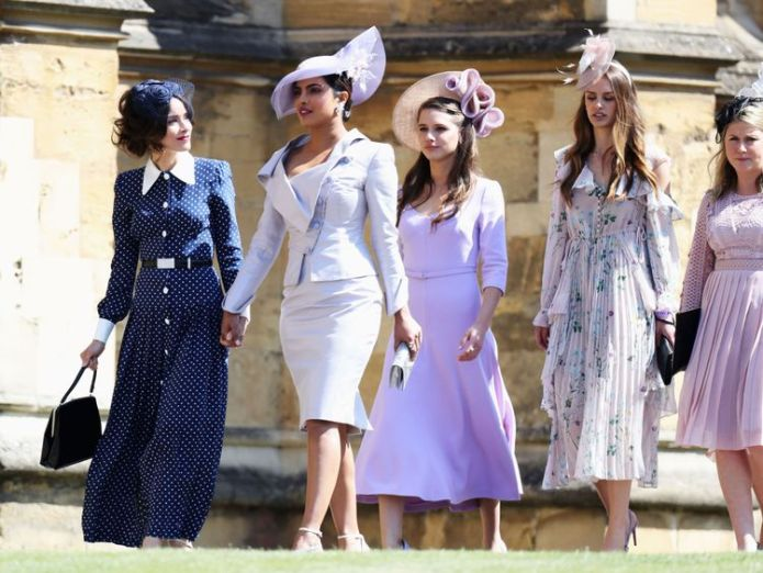 Priyanka Chopra (second left) arriving for Meghan Markle and Prince Harry's wedding in Windsor  Priyanka Chopra apologises over Quantico Hindu storyline Priyanka Chopra apologises over Quantico Hindu storyline skynews priyanka chopra royal wedding 4332562