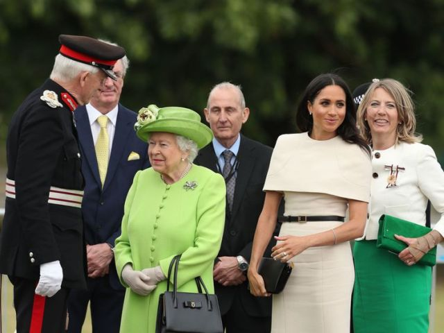 The Queen appeared to go green for Grenfell during the visit