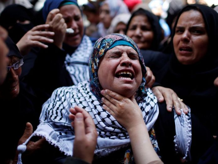 A relative mourns during the Razan's funeral Hamas warns of 'bloodier' Gaza protests and demands easing of economic blockade Hamas warns of 'bloodier' Gaza protests and demands easing of economic blockade skynews razan al najar gaza 4326525