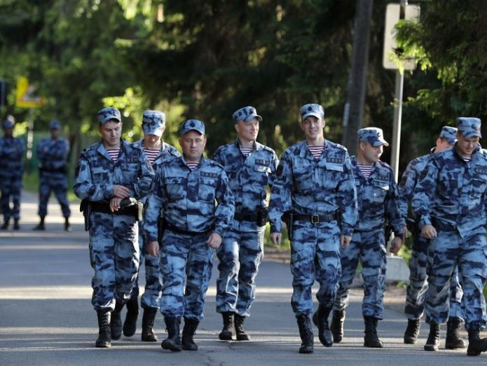 Police outside the England squad's base in Repino, Russia England footballers arrive in Russia amid racism row England footballers arrive in Russia amid racism row skynews russia england world cup 4334415