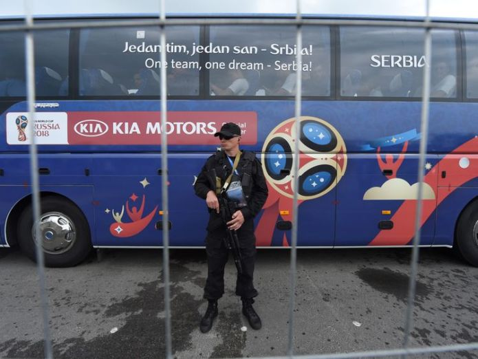 A Russian police officers stands guard as Serbia's national football team bus leave Hrabrovo airport in Kaliningrad on 11 June, 2018 ahead of the Russia 2018 World Cup. (Photo by ATTILA KISBENEDEK / AFP) (Photo credit should read ATTILA KISBENEDEK/AFP/Getty Images)  Hundreds banned from World Cup have passports seized Hundreds banned from World Cup have passports seized skynews russia world cup police 4334848