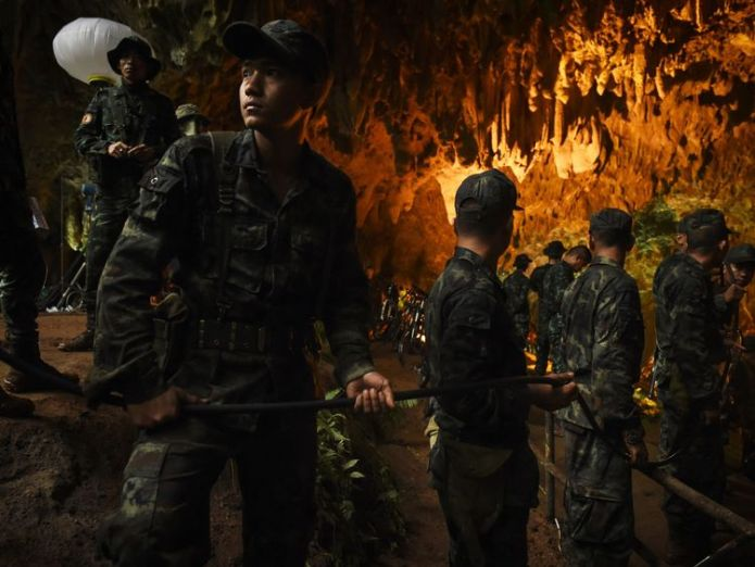 Thai soldiers relay electric cable deep into the Tham Luang cave  British divers join mission to save football team from Thai cave skynews thailand cave footballers 4346218