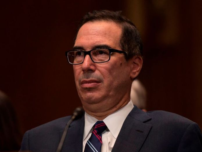 US Treasury Secretary Steven Mnuchin testifies before a Senate Appropriations Committee for Financial Services hearing on the proposed FY2019 budget for the Treasury Department in Washington, DC on May 22, 2018. (Photo by Andrew CABALLERO-REYNOLDS / AFP) (Photo credit should read ANDREW CABALLERO-REYNOLDS/AFP/Getty Images)   US imposes fresh sanctions over Russian cyber attacls skynews treasury mnuchin 4333453