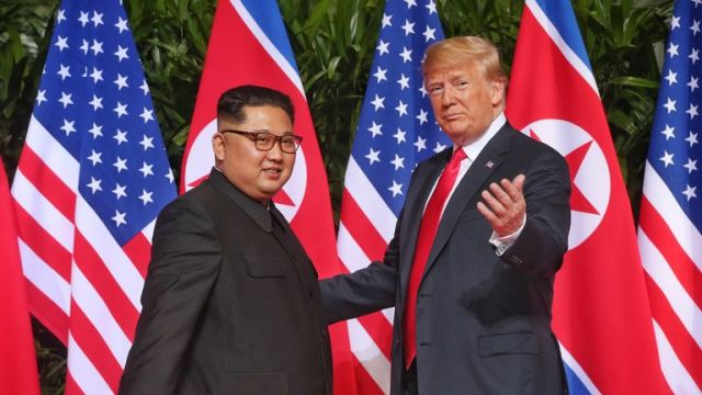 SINGAPORE - JUNE 12: In this handout photo, North Korean leader Kim Jong-un (L) meets U.S. President Donald Trump during their historic U.S.-DPRK summit at the Capella Hotel on Sentosa island on June 12, 2018 in Singapore. U.S. President Trump and North Korean leader Kim Jong-un held the historic meeting between leaders of both countries on Tuesday morning in Singapore, carrying hopes to end decades of hostility and the threat of North Korea's nuclear program. (Photo by Kevin Lim/THE STRAITS TIM
