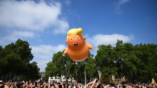 A 'Baby Trump' balloon rises after being inflated in London's Parliament Square