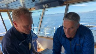 Lewis Pugh studies the map with Royal Navy captain Matt Syrett