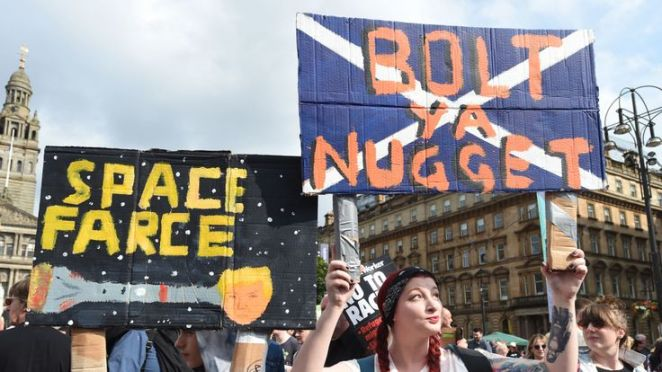 Demonstrators gather in George Square, Glasgow, for the Scotland United Against Trump protest against the visit of US President Donald Trump to the UK.