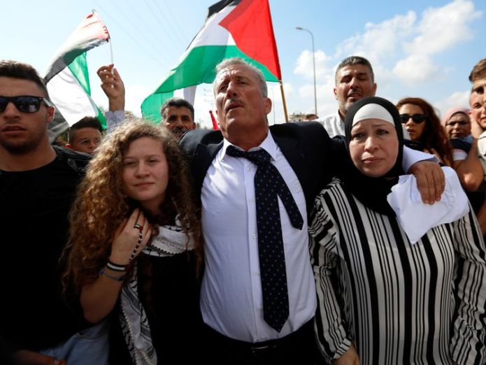 Palestinian teenager Ahed Tamimi and her mother Nareman walk out after they were released from an Israeli prison  Palestinian teenager who slapped Israeli soldier released skynews ahed tamimi israel 4374711