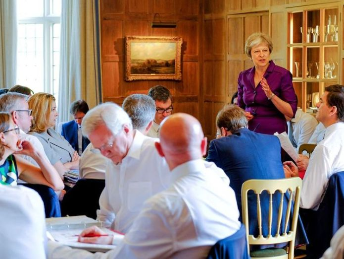 Theresa May speaking to the cabinet during crunch Brexit talks at Chequers. Pic: Crown Copyright  Theresa May meets Emmanuel Macron to find way through Brexit impasse skynews chequers brexit 4355337
