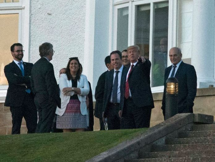 Donald Trump with members of his staff at the Trump Turnberry resort. Pic: John Linton/PA Wire  US agent dies after suffering stroke during Donald Trump's visit to Turnberry golf resort skynews donald trump donald trump turnberry 4361629